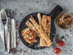 Fette di focaccia con pomodorini,olive,finocchio,basilico e aglio image