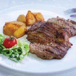 Ceafă de porc la grătar și cartofi wedges image