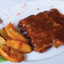 Coaste de porc barbeque și cartofi wedges image